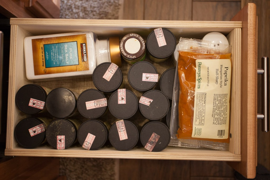 Image of herb and spice bottles filling drawer
