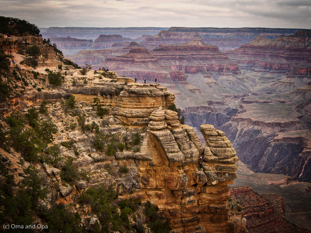 The canyon dwarfs people, and the mighty Colorado appears as little more than a thread in the distance