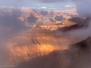 The clouds clear allowing late-afternoon light to reach the canyon