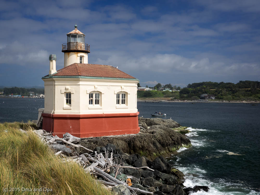 Coquille River lighthouse, with Bandon in the distant background