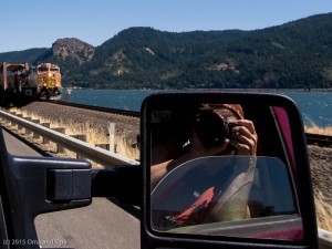 Self portrait with BNSF engines exiting bridge in Washington